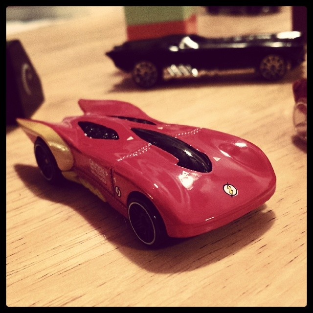 Flash themed Hot Wheels car from a Justice League set. You can see the Batmobile in the background.