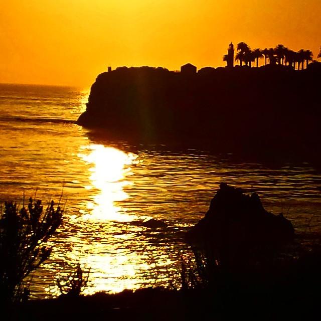 Sea cliff sunset.