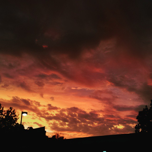 And in the opposite direction, a fiery sunset.  #sunset #clouds #orange
