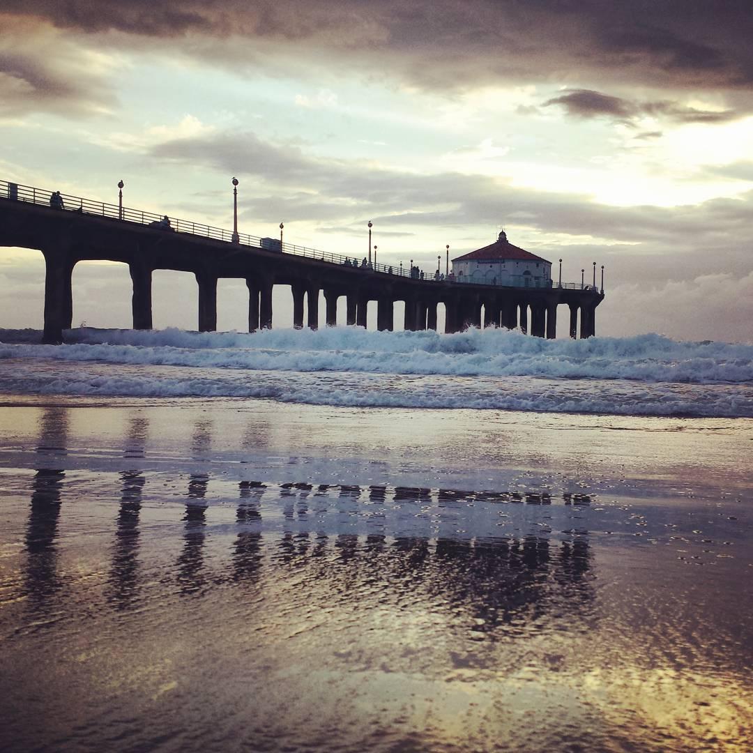 Pier reflection.  #manhattanbeach #pier #beach #clouds #california #gloomy #waves #ocean #reflection