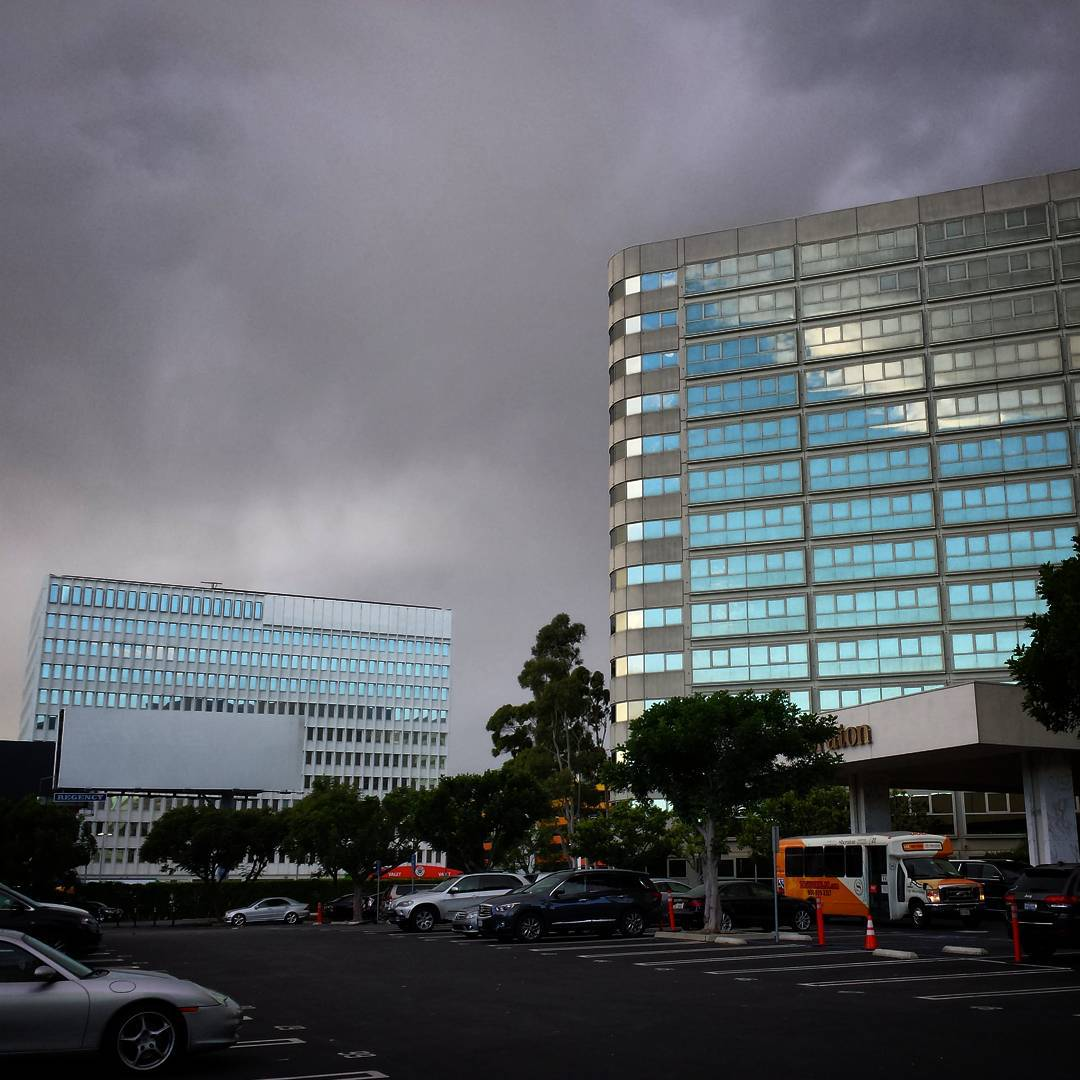 Gloom ahead, bright blue sky reflected from behind. The rain started about 5 minutes later.  #gloomy #reflection #sky