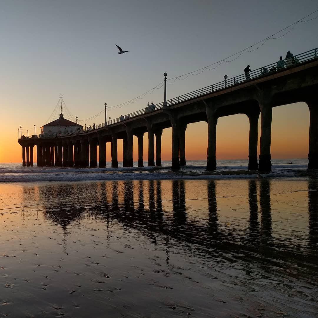 Pier reflection.  #pier #manhattanbeach #manhattanbeachpier #sunset #ocean #beach #reflection