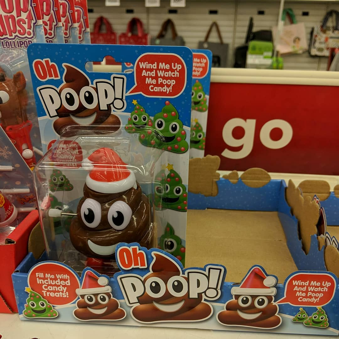 Not sure if I'm more appalled by the idea of smiling plastic poop that poops smiling candy poop, or amused by the shelf placement