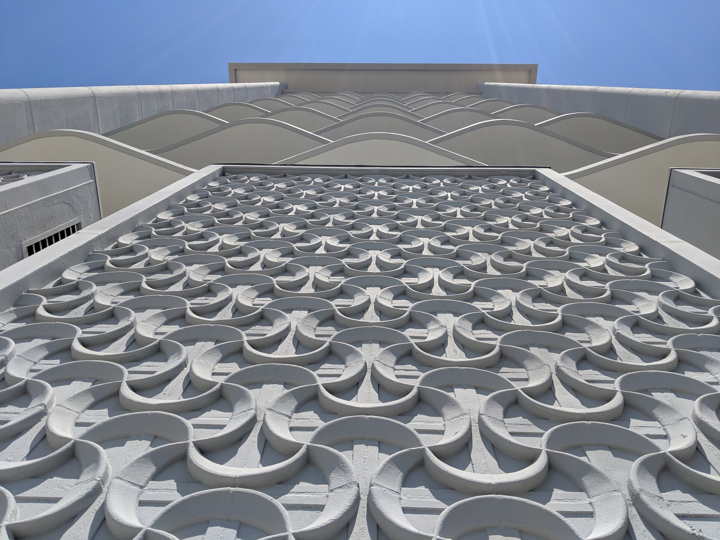 Curved patterned facade