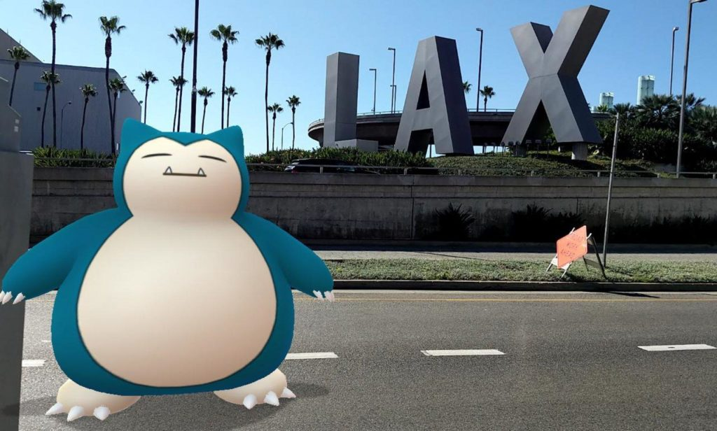 A Snorlax next to the giant LAX sign at Los Angeles' airport.