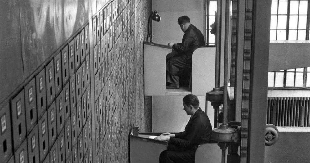 Elevator desks for the world's largest file cabinet.
