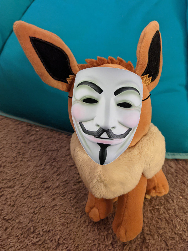 An Eevee plush (Pokemon) with a superimposed Guy Fawkes mask.