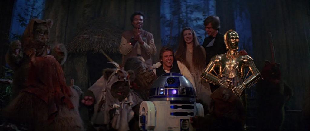 Rebels and Ewoks celebrating in Return of the Jedi.