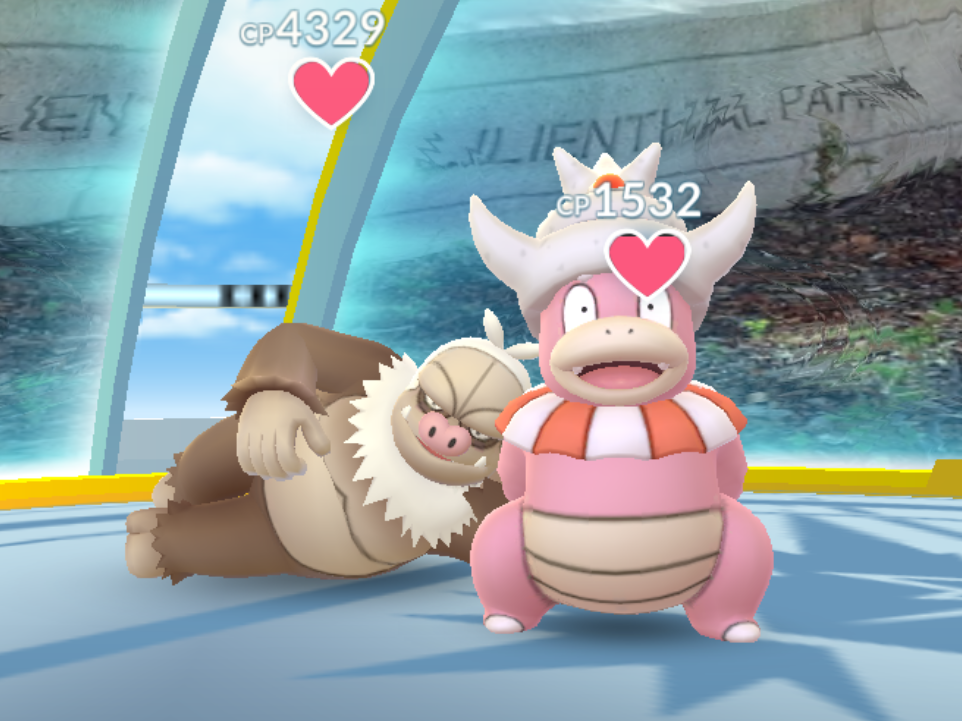 A Slaking and a Slowking at a Pokemon Go gym.